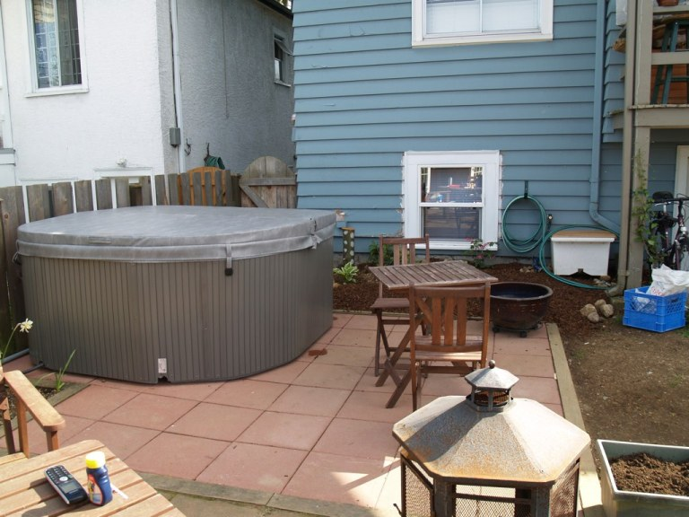The new hottub in our shady corner.