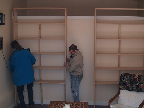 Brian and Chris move my bookshelves into the studio.