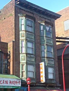 One of my favourite decaying buildings in Chinatown - the facade is tin and rusting away.