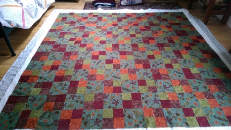 Finished piecing and pin-basted a quilt I started Ten years ago.
